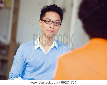 Young candidate having an interview with his employer poster