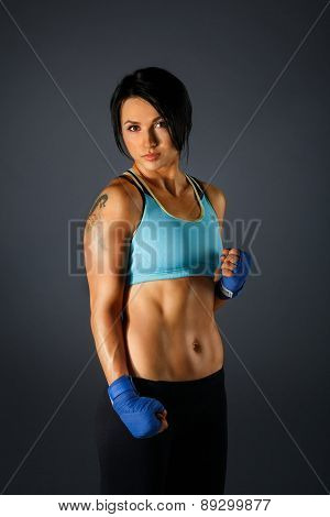 Youmg Sportive Woman At Grey Background