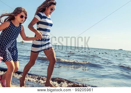 Happy Carefree Family Running On Beach At Sea.