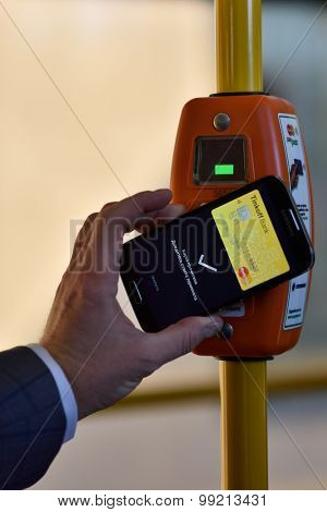 ST. PETERSBURG, RUSSIA - AUGUST 17, 2015: Vice president of Mastercard in Russia Anton Shigapov demonstrate the PayPass technology in transport ticketing system implemented in the line 5 trolleybus