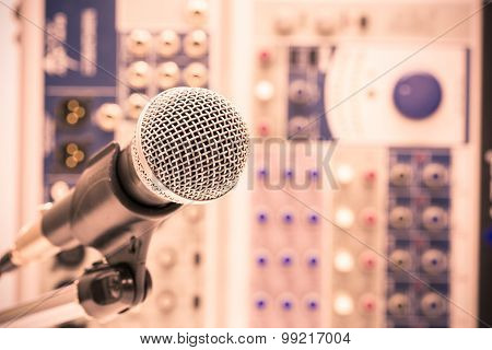 Microphone with retro picture style, Close up of microphone in concert hall or conference room