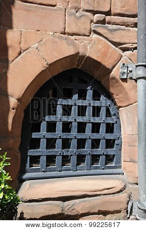 Small window with security bars in St Marys Guildhall Coventry West Midlands England UK Western Europe. poster