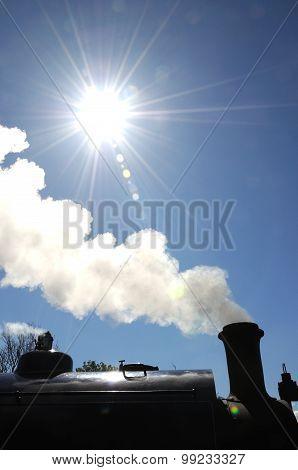 Steam train silhouetted.