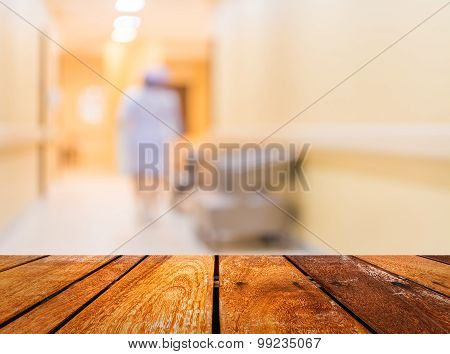 blur image of nurse in hospital walkway for background usage. poster