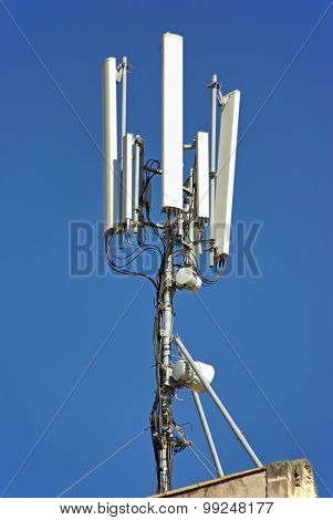 Antenna used to repeat the signal on a mobile telephony network poster