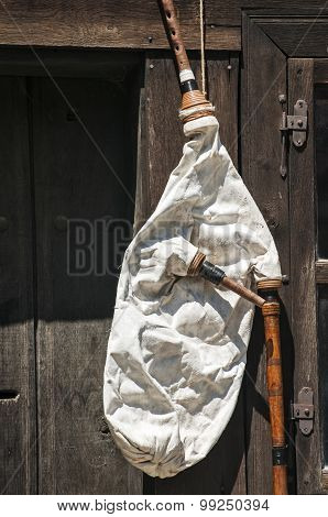 Bagpipe on wooden wall