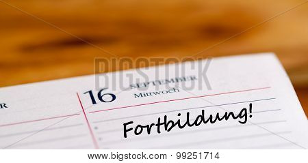 the german word Fortbildung writen on a calender page