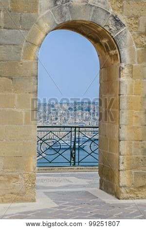 Waterfront Views Through Arched Passageway