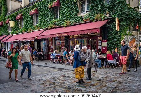 Marais street scene with older couple