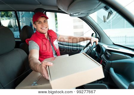 Courier Delivering Package By Van