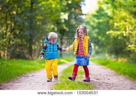 Kids Running In Autumn Park