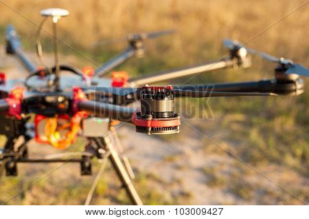 The Engine copter. UAV in flight. Quadrocopters on radio. poster