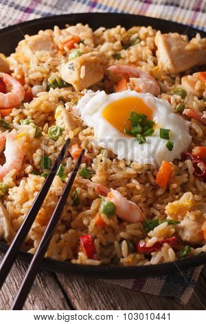 Nasi Goreng With Chicken, Shrimp And Vegetables Close-up Vertical