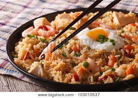 Fried Rice Nasi Goreng With Chicken And Shrimp Close-up Horizontal