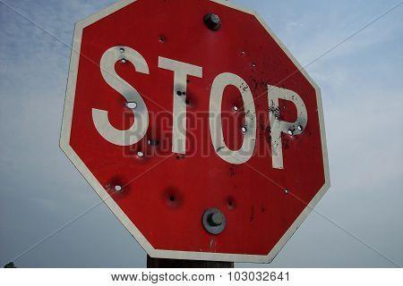 Shotgun Blast Stop Sign