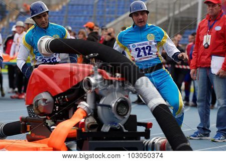 ST. PETERSBURG, RUSSIA - SEPTEMBER 9, 2015: Team Kazakhstan during competitions in combat deployment during XI World Championship in Fire and Rescue Sport. First World Championship was held in 2002