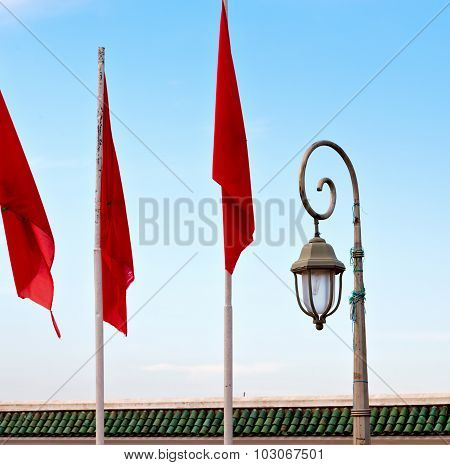 Tunisia  Waving Flag In The Blue Sky  Colour And Street Lamp