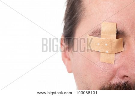 Man´s Eye Glued Medical Plaster, Isolated On White, Concept First Aid