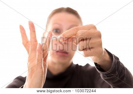 Woman Shows Her Sticky Hands With Cobwebby Fingers, Isolated On White