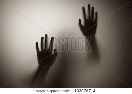 Horror hand. Diffused silhouette