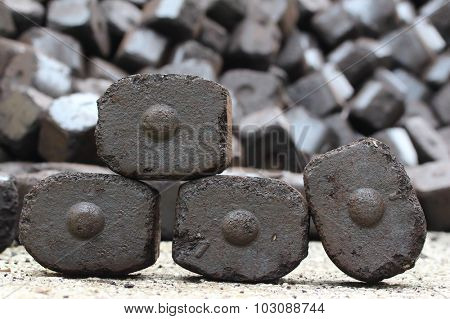 Brown coal briquettes as a industrial background.