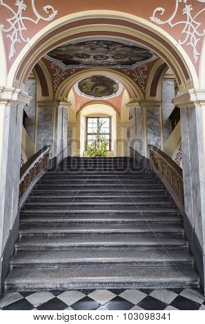 WROCLAW, POLAND - AUGUST 04, 2013: The main staircase of an old building with a beautiful painted ceiling