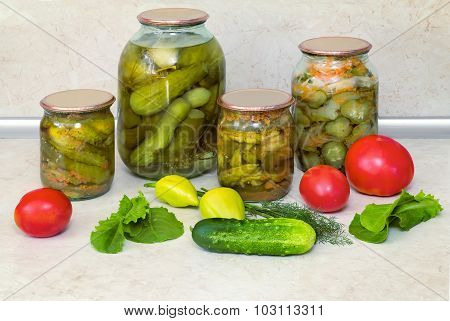 Canned Cucumbers With Spices In Glass Jars.