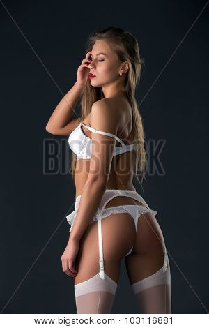 Back view of handsome model in erotic lingerie