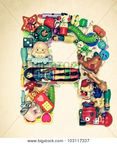 the letter R made from small toys