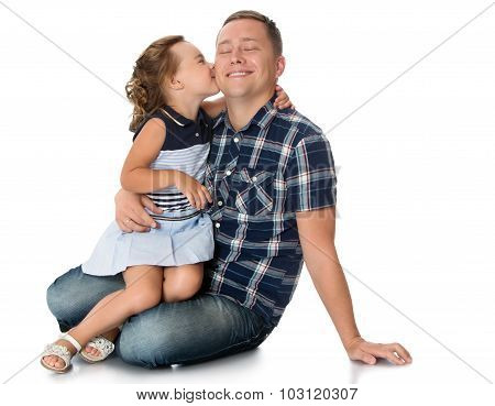 Girl embraces Dad