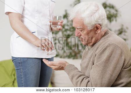 Private Nurse Giving Medicines