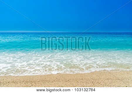 Beach, only sand and crystal clear water.