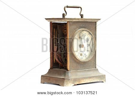 Old broken mantel clock on a white background