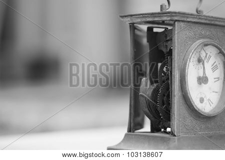Black and white photo of old mantel clock