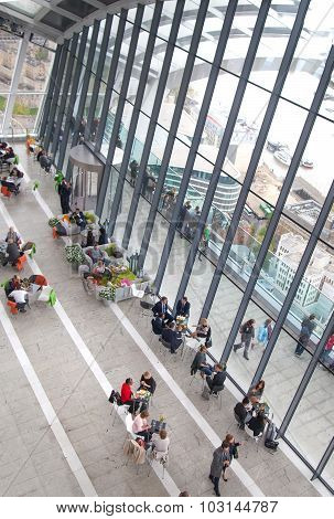 LONDON, UK - APRIL 22, 2015: People in the restaurant of the Sky Garden Walkie-Talkie building. View