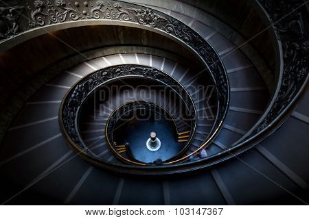 Long spiral, winding stairs. Dark shadows, mysterious mood with single soft light.