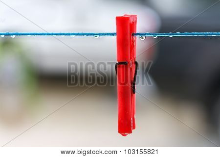 Red clothes peg.