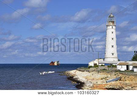 Old Lighthouse On The Beach