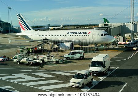 ROME, ITALY - AUGUST 16, 2015: docked jet aircraft in Fiumicino Airport. Fiumicino - Leonardo da Vinci International Airport is a major international airport in Rome, Italy