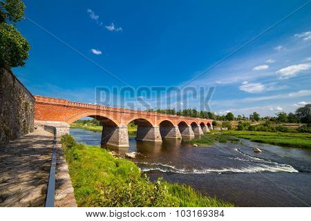 Old brick bridge over river Venta at Kuldiga, Latvia