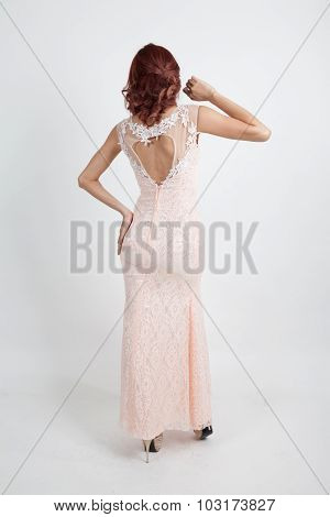 Back Full Portrait Of A Beautiful Girl In A Light Pink Dress Isolated On Overwhite Background
