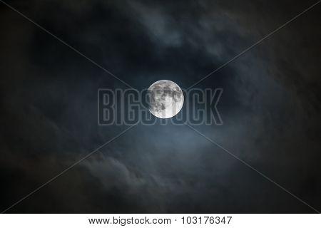 Lunar Eclipse Beginning in Dark, Cloudy Sky
