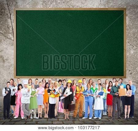 Large Workers People group near blackboard background.