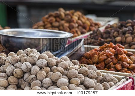Dry fruits and spices like cashews raisins cloves anise etc. on display for sale in a bazaar in Osh Kyrgyzstan. poster
