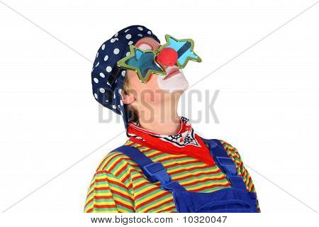 Clown is thoughtfully looking upwards