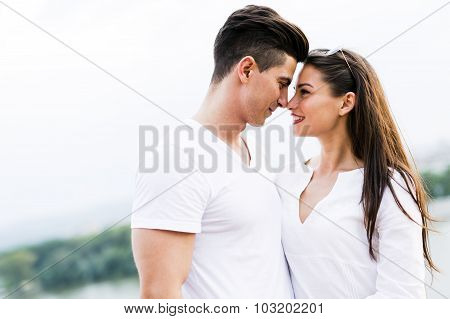 Young Beautiful Couple Rubbing Noses As A Sign Of Love