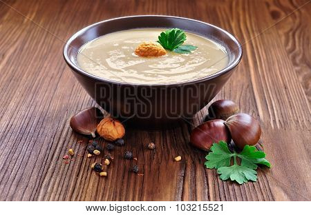 Chestnut soup of rustic stile on a wooden table