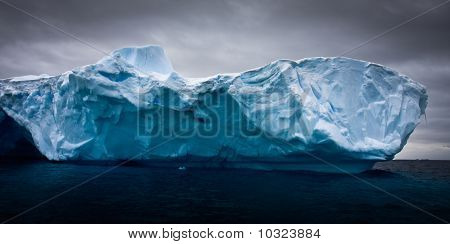 Antarctic iceberg in the snow floating on water poster