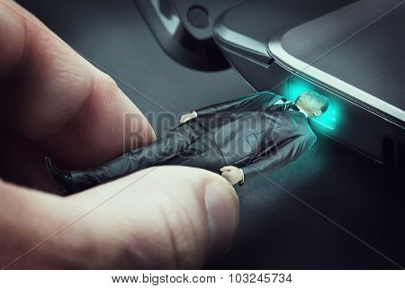 Man is plugged into the laptop as a flash drive