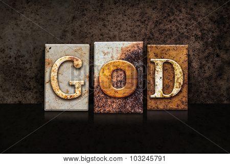 God Letterpress Concept On Dark Background
